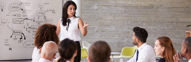 Woman presenting to small group